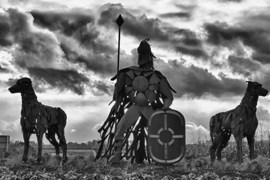 Fionn mac Cumhaill, the Rífhéinní, with his hounds Bran and Sceolaing reimagined in a modern sculpture, Ireland