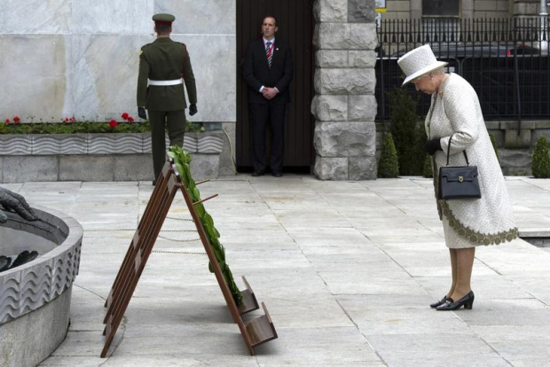 Queen Elizabeth II, the British head of state, bows her head to honour Ireland's Irish Republican revolutionaries, the Garden of Remembrance, Dublin, 2011