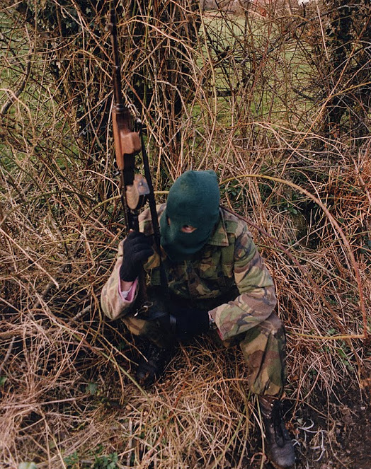 A Volunteer of the Irish Republican Army armed with an AKM assault rifle on patrol, British Occupied North of Ireland, 1994