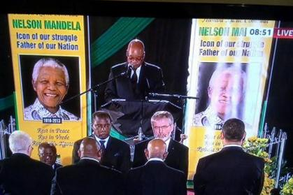 Specially invited by the ANC the president of Sinn Féin, Gerry Adams TD, is greeted with applause as he joins the Guard of Honour at the funeral of Nelson Mandela, the late president of South Africa, 2013