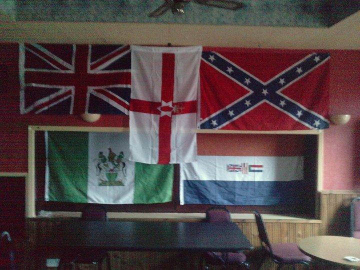 In a building used by the Orange Order some members of the British Unionist minority in Ireland display the banners of various racist or colonial regimes from across history, including British Rhodesia, Apartheid South Africa and the Confederate States of America