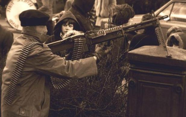 AVolunteer of the Derry Brigade of the Irish Republican Army armed with an M60 general-purpose machine gun