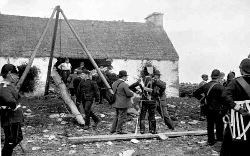 The RIC and British troops forcing Irish family from their home during the Land War (collective punishment in effect), 1898
