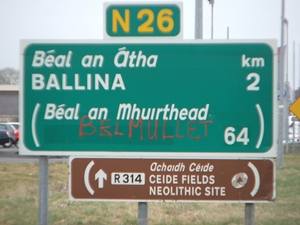 A sign for Béal an Mhuirthead is defaced as Belmullet - a symbol of Anglophone racism in Ireland, both ancient and new