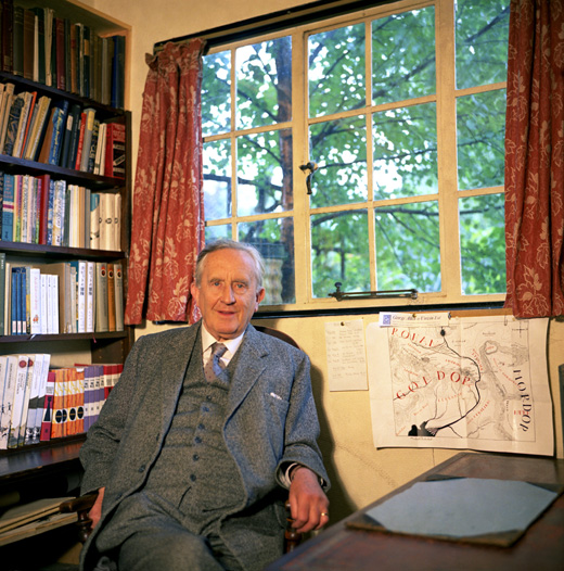 J.R.R. Tolkien in his study with a map of Middle-earth