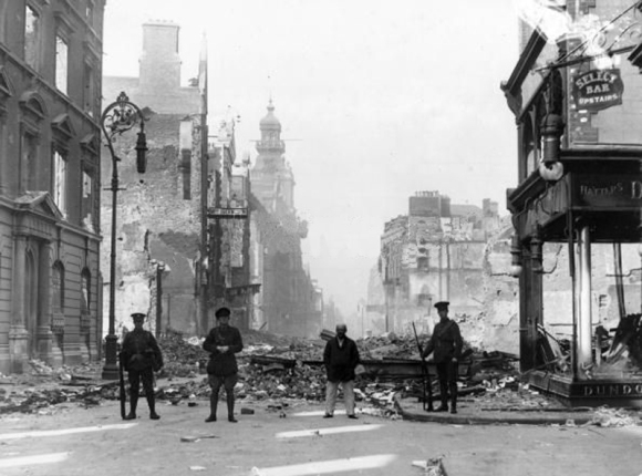 Soldiers of the British Occupation Forces on guard in front of rubble in the city-centre of Dublin in the aftermath of the Easter Rising of 1916