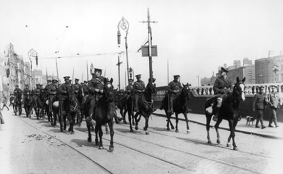Troops of the Ulster Volunteer Force, a British Unionist militia in Ireland, move into Dublin to support the British Forces during the Easter Rising of 1916. The presence of UVF men in the capital - regarded by many as terrorists - worsened tensions in the city