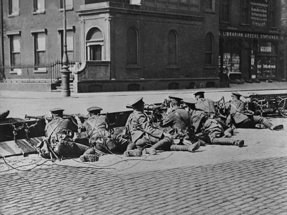 British troops seal off a street in Dublin city-centre with an improvised barrier during or shortly after the Easter Rising of 1916