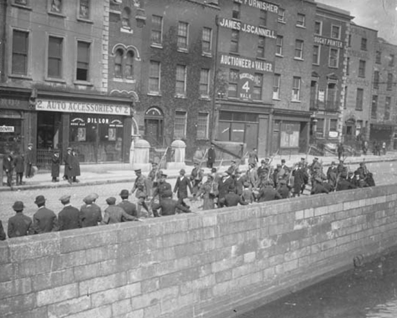 POWs of the Irish Republican Army under British military escort being marched along the quays in Dublin to detention camps in the capital in the days after the Easter Rising of 1916