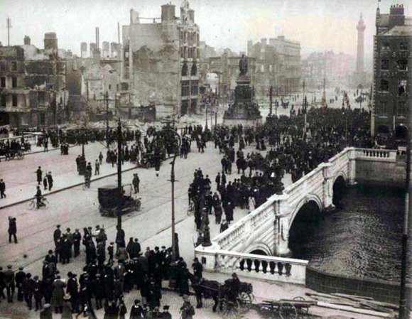Crowds on O'Connell Street, Dublin, in the days after the Easter Rising of 1916, with buildings destroyed by British artillery and machine-gun fire all around