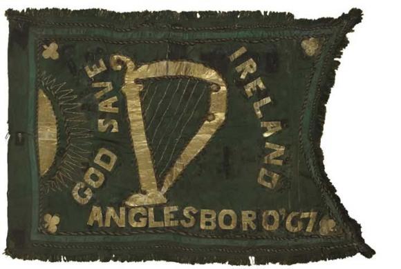 An Irish or Fenian Sunburst flag featuring the harp with the sunburst to the left, Ireland 1867