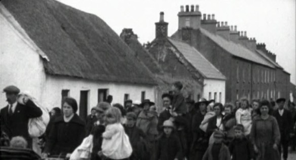 A column of Irish refugees fleeing the ruins of their homes following the Sack of Balbriggan