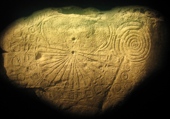 One of the carved stones at the ancient Brú na Bóinne burial mound. A 4000 year old Irish Sunburst? Almost certainly not but an interesting artistic parallel