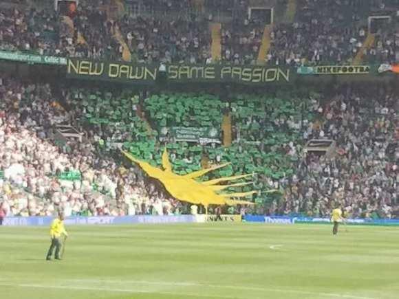 Celtic fans display a Fenian or Irish Sunburst at match, Glasgow, Scotland