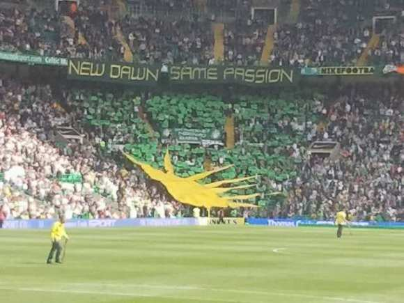 Celtic fans display a Fenian or Irish Sunburst at match, Glasgow, Scotland