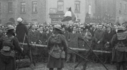Troops of the British Occupation Forces line the barricades in Dublin City during an Irish Republican rally, the War of Independence, Ireland, 1920