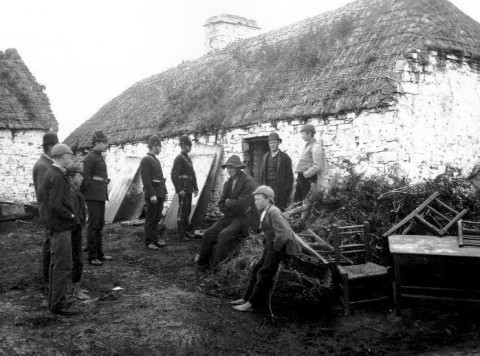 An Irish family forced from their home by the Royal Irish Constabulary or RIC as their land is seized by a British colonial landlord during the Land War, Ireland, 1879