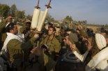 Israeli soldiers pray before a Torah, southern Israel, 2012 (AP Photo - Ariel Schalit)