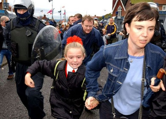 Holy Cross Girls Primary School, Belfast, under siege by British Unionist gangs, 2001 (Photo: Justin Kernoghan)