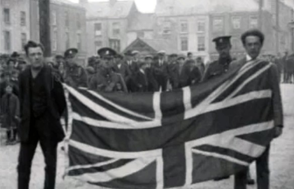 Two Irishmen forced to parade around Dungarvan by British troops with a British flag tied around their necks. Both were later beaten and dumped outside the town. The War of Independence, Ireland, 1920