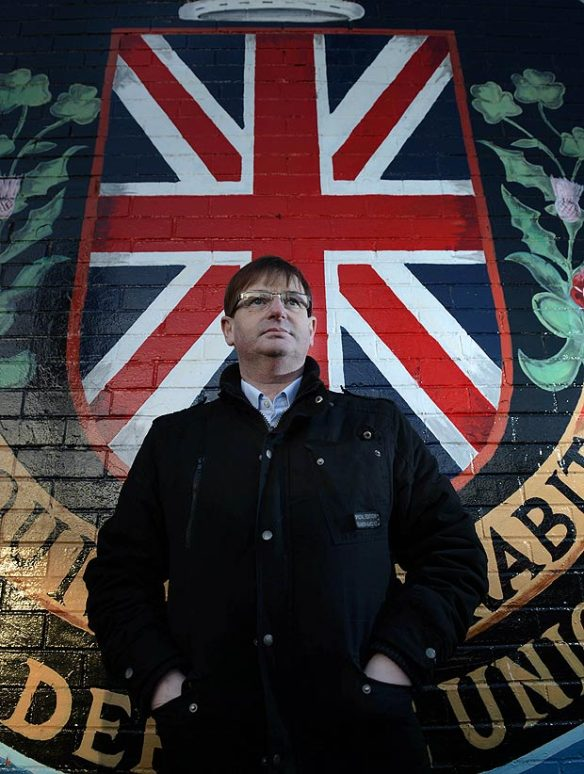 Anti-democracy protest leader and British Unionist militant Willie Frazer poses in front of a British terrorist wall mural, Belfast, Ireland