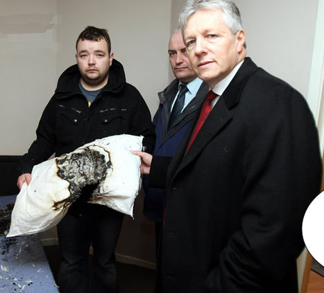 Former DUP member and convicted terrorist John Smyth Junior pictured with his party leader Peter Robinson in 2010. He is the son of DUP councillor John Smyth, who was similarly convicted of British terror attacks.