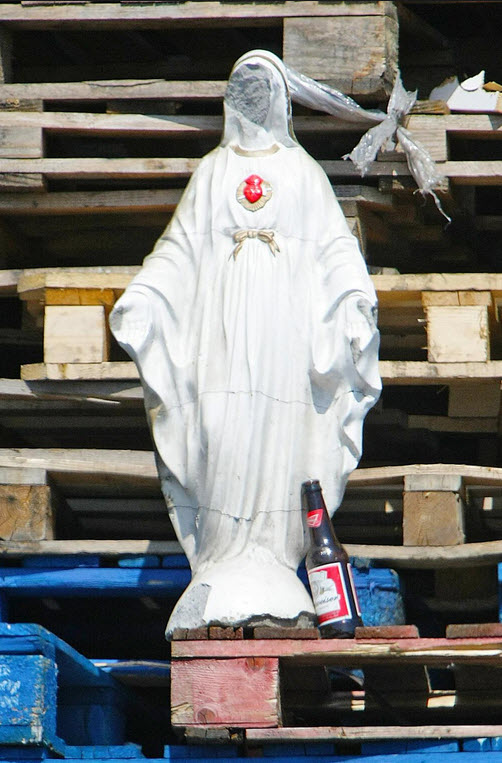 A Roman Catholic religious icon defaced and ready for burning by British Unionists, Belfast, Ireland 2013
