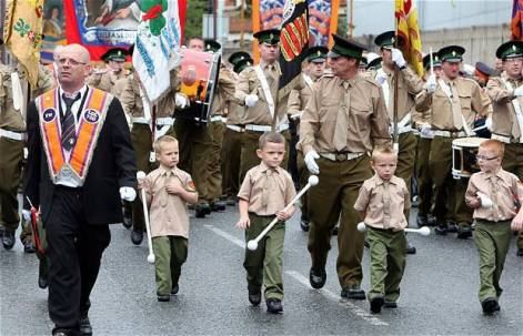 A British military-style band affiliated with the Orange Lodge marches through Belfast on July 12th