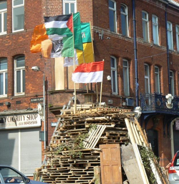 Irish, Polish, Palestinian and Vatican flags ready to be burned by British Unionists, Belfast, Ireland 2013