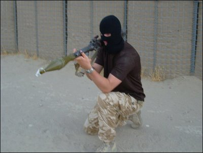 A British soldier in Afghanistan poses as a British terrorist in Ireland, complete with balaclava mask and RPG7 rocket-launcher