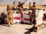 In Afghanistan soldiers of the RIR, a British Army unit, pose as UVF terrorists in front of an extremist flag