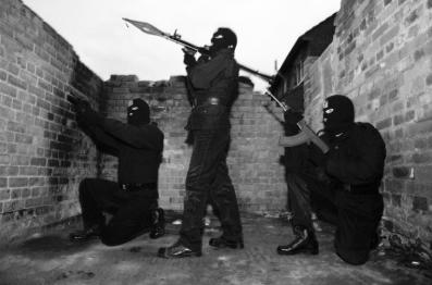 Masked British terrorists in Ireland stage a propaganda event for the camera, one holds an RPG7 rocket-launcher