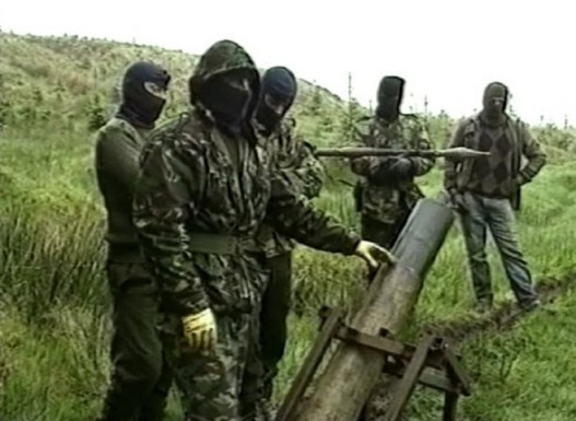French TV crew are shown a mortar being prepared for an attack by a Volunteer of the Irish Republican Army, British Occupied North of Ireland, early 1990s