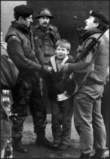 A terrified Irish boy is interrogated by soldiers of the British Army's Gloucestershire Regiment, West Belfast, Ireland, March 1972