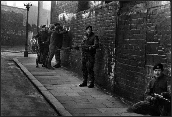 Soldiers of the British Army's Gloucestershire Regiment interrogating and searching local Irish civilians, West Belfast, Ireland, March 1972