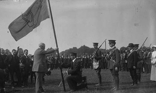 John Redmond MP presents a regimental flag to a unit of the Irish National Volunteers, the paramilitary wing of the Irish Parliamentary Party, the Phoenix Park, Dublin, Ireland, April 1915