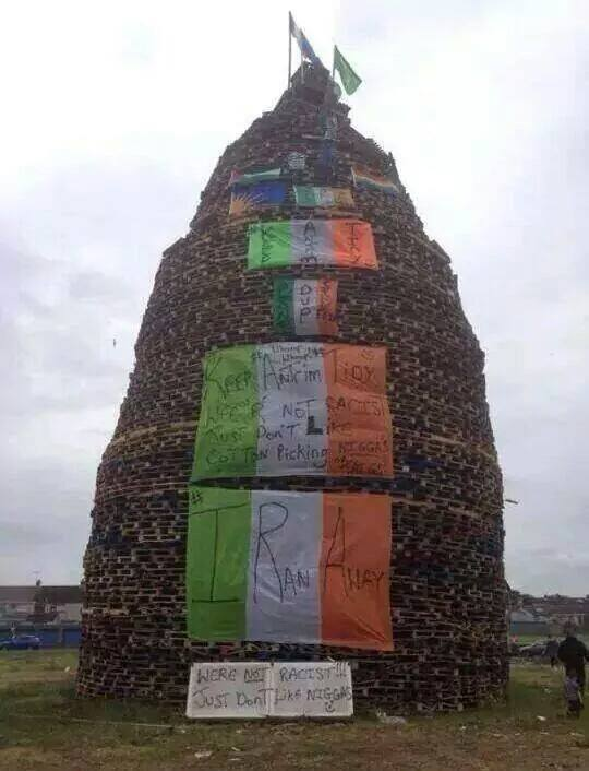 A British Unionist and Orange Order bonfire decorated with sectarian and racist messages, Ireland, July 2014