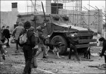 A British armoured vehicle is attacked by civilians in an Irish Nationalist enclave of Belfast, the Occupied North of Ireland