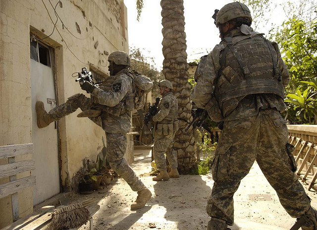 American soldiers prepare to storm a building in Iraq