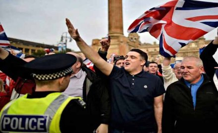 Anti-Scottish British unionist and nationalist extremists holding anti-independence signs while giving Nazi salutes