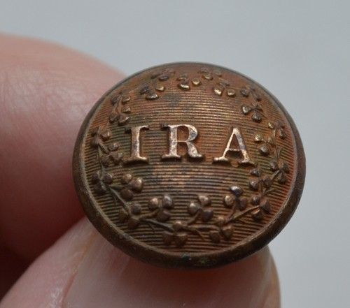 Brass button from the uniform a Fenian volunteer inscribed with the letters IRA or Irish Republican Army, Canada, 1870