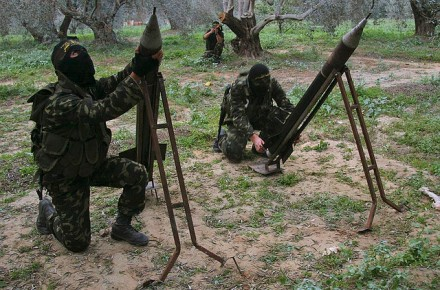 In the Gaza Strip region of Occupied Palestine several Palestinian insurgents with Islamic Jihad prepare for an attack on targets in Israel