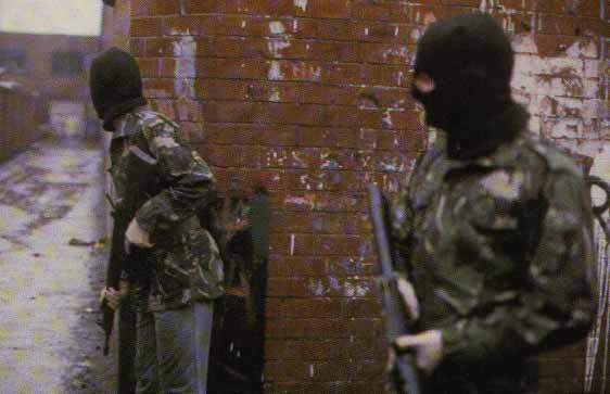Volunteers of the Belfast Brigade of the Irish Republican Army preparing for an attack, British Occupied North of Ireland, 1989