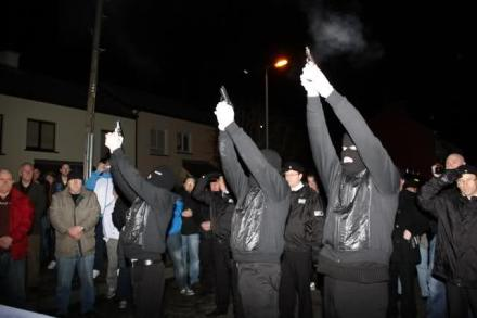 A Republican honour guard fires a volley of shots over the coffin of Jim Gallagher, a prominent member of the Republican Network for Unity or RNU, 2010