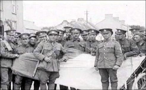 British troops pose with an Irish Tricolour captured from Pro-Treaty and Anti-Treaty Irish Republican Army units following the Battle of Pettigo and Belleek in late May and early June of 1922