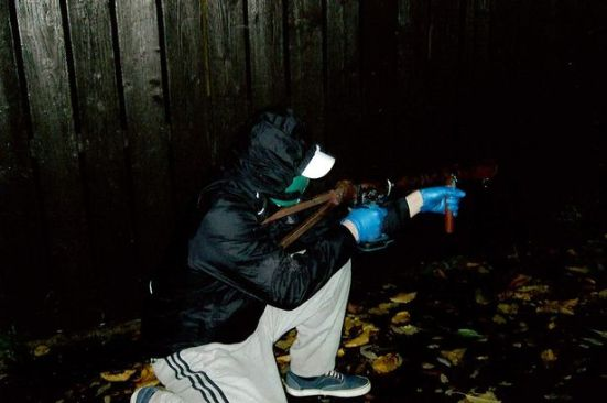 A Volunteer of the (New) Irish Republican Army holding a (N)IRA-manufactured grenade-launcher just before an attack on the British Forces in Belfast, 2014