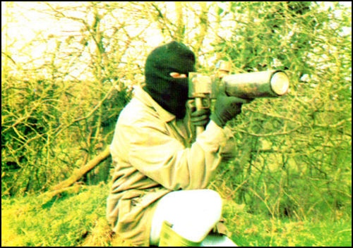 A Volunteer of the (Provisional) Irish Republican Army armed with a short-barrelled Mark 15 Projector Recoilless Improvised Grenade or PRIG launcher