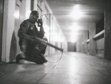 A British soldier of the First Gloucestershire Regiment pictured inside the Divis Flats, Belfast 1972, with a walkie-talkie radio