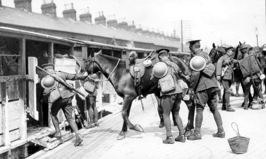 Gunners of the Royal Field Artillery load their horses onto a train bound for the Pettigo-Belleek salient, Ireland, 3rd June 1922