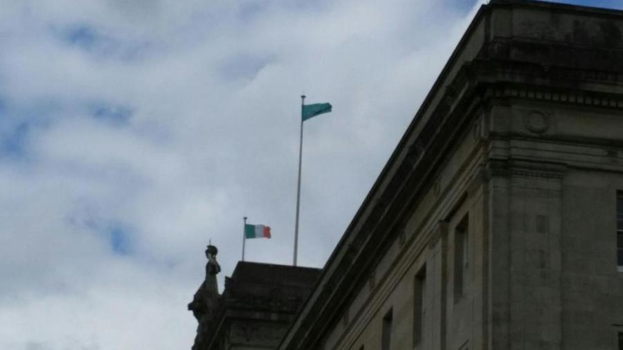 Ireland's national flag flies over the north-eastern assembly building at Stormont
